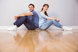 Couple both sitting on floor