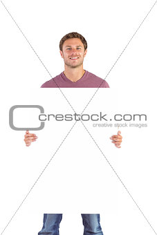 Man holding up a sign