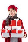 Smiling woman holding large presents