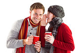 Couple both having warm drinks