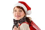 Smiling woman wearing santa hat