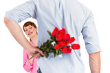 Man holding roses behind him