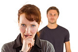 Worried woman with man behind