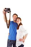Couple using camera for picture