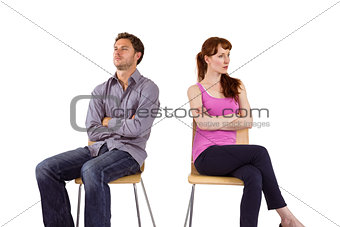 Sitting couple ignoring each other