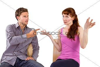 Sitting couple having an argument