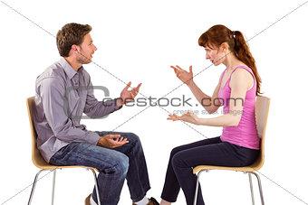 Sitting couple having an argument