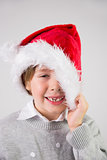 Child wearing a santa hat