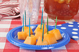 Cantaloupe on a picnic table