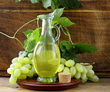 jugful with grape seed oil on a wooden table