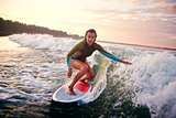 Woman surfboarding
