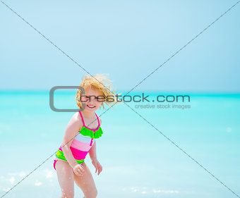 Portrait of baby girl at seaside