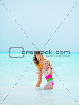 Portrait of mother and baby girl at seaside