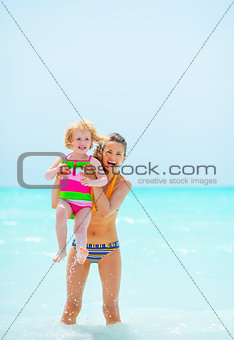 Portrait of mother and baby girl in sea