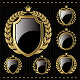set of vector golden emblem with shield and wreaths