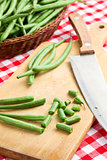 bean pods with knife