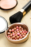 bronzing pearls and makeup brush