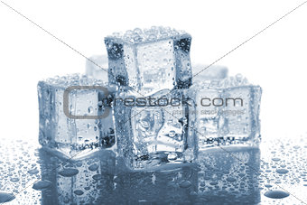 Six melted ice cubes with water drops