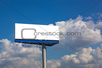 Blank billboard on blue sky with clouds