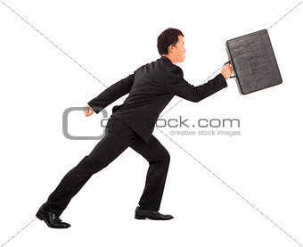 positive businessman running and holding briefcase