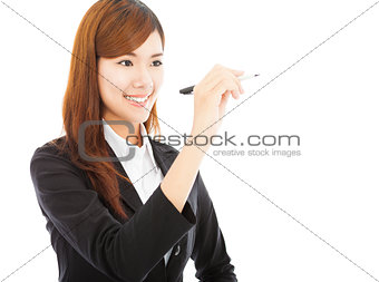 smiling business woman standing and holding a pencil