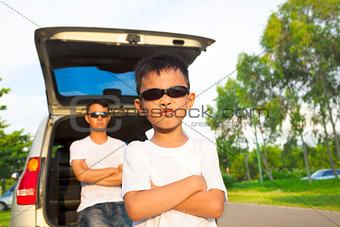 little boy and father with their car in the park