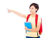 happy student girl holding book and pointing
