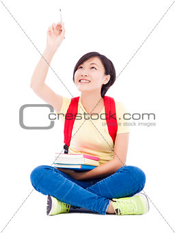 asian student girl sitting  and drawing over white background