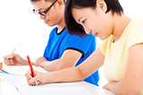 two young students learning together in classroom