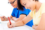 two young students studying together in classroom