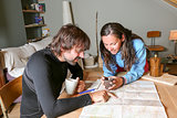 couple mountaineers planning the route