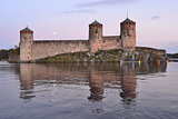 Savonlinna.  Fortress Olavinlinna at sunset