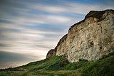 Long exposure landscape of motion blur sky over vibrant cliffs