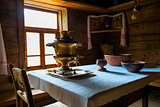 brass samovar on the table in the Russian hut