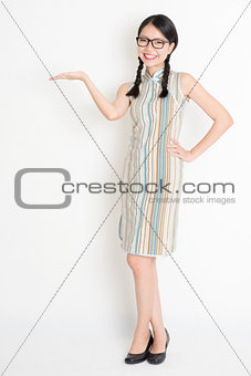 Asian Chinese girl palm holding something