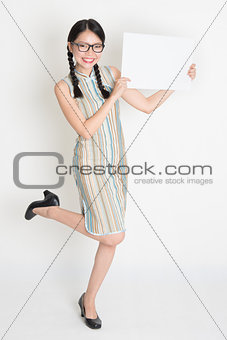 Asian Chinese female hands holding a blank white card