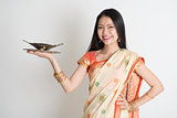 Indian housewife hand holding empty plate