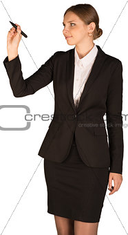 Beautiful girl in business suit holding pen and writing