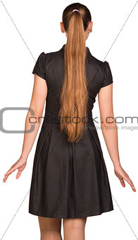 Attractive young woman in black dress. Rear view