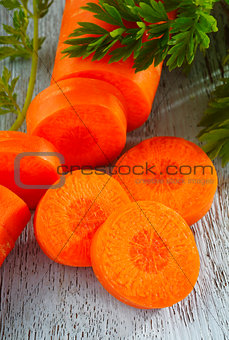slice carrot on wooden background