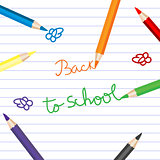 Back to school with colored pencils over notebook paper