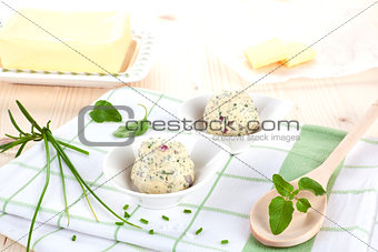 Dairy products. Butter and herbal butter on wooden table.