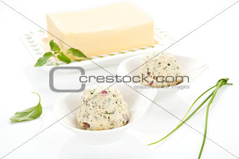 Dairy products. Butter and herbal butter on white background.