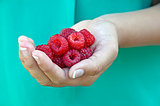 raspberry in girl's hand