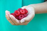 raspberry in girl's hand