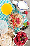 Healthy breakfast with muesli, berries, orange juice and milk