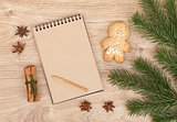 Christmas fir tree, gingerbrean man and blank notepad