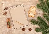 Christmas fir tree, gingerbrean man and blank notepad