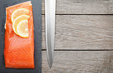 Fresh salmon fish with lemon and japan knife