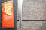 Fresh salmon fish with lemon and japan knife